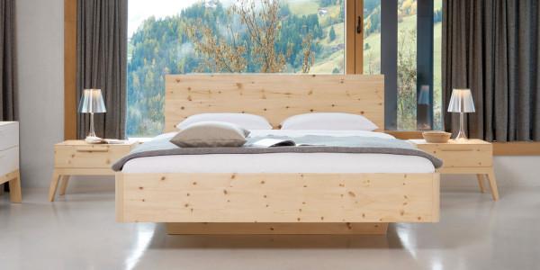 Bett mit schwebender Optik und abgerundeten Ecken